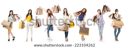 Attractive Asian women shopping and holding bags, full length portrait isolated on white background. - stock photo