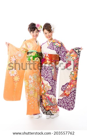 attractive asian women wearing traditional kimono on white background - stock photo