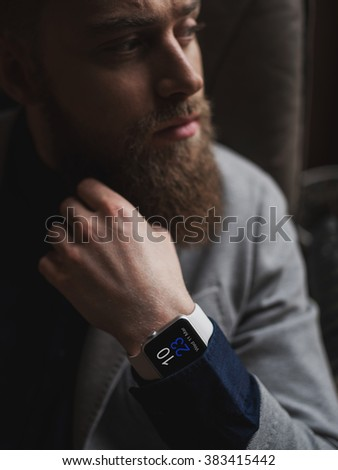 Attractive bearded businessman is very thoughtful - stock photo