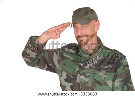 Attractive bearded middle aged  smiling soldier, pride expression on face is saluting - stock photo