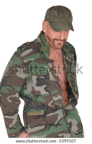 Attractive bearded middle aged  smiling soldier, pride expression on face, jacket open, showing hairy chest - stock photo
