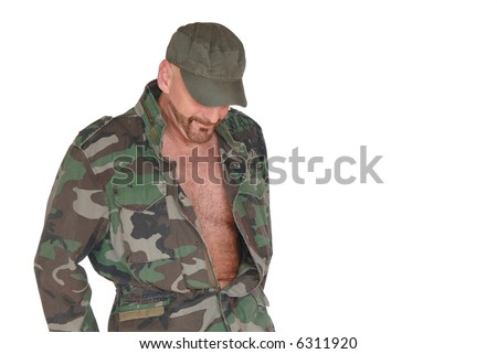 Attractive bearded middle aged  smiling soldier, pride expression on face, open jacket showing hairy chest - stock photo