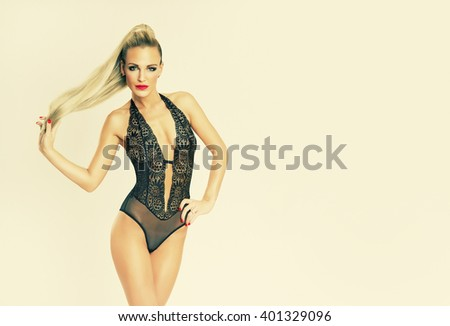 attractive beautiful slim blonde girl in black lingerie