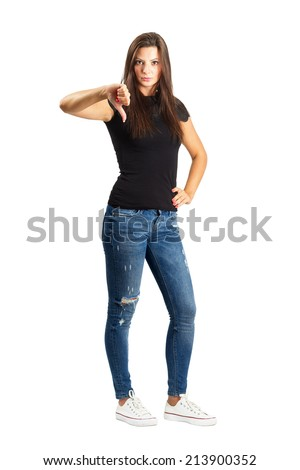 Attractive beautiful woman showing thumb down gesture.  Full body length isolated over white. - stock photo