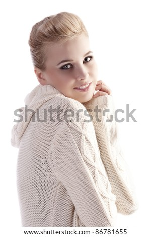 attractive beautiful woman wearing a white wool sweater in a fashion shot with an elegant up do - stock photo