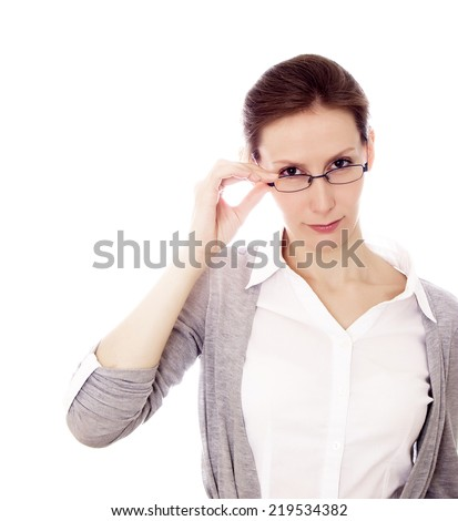 Attractive beautiful young caucasian woman / girl / female in spectacles / glasses / specs staring at something with curiosity / interest (some text or product image) isolated on white background   - stock photo