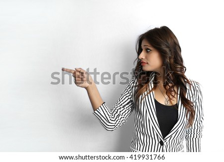 Attractive beautiful young Indian business woman pointing her finger gesture isolated on white background - stock photo
