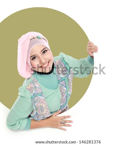 Attractive beautiful young woman in circle showing at camera - stock photo