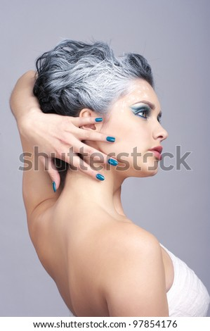 Attractive beauty with creativity hairstyle and winter style make-up - stock photo
