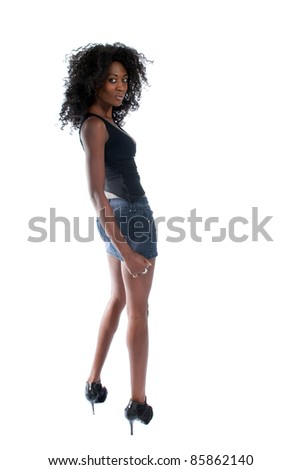 Attractive black woman poses in shorts and shirt