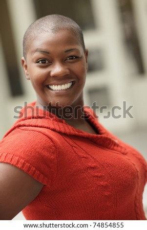 Attractive black woman with short hair - stock photo