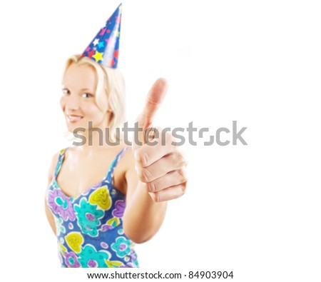 Attractive blond at party showing thumbs up