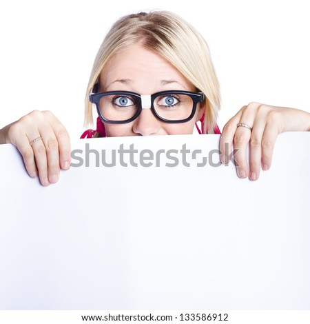 Attractive blond businesswoman looking over top of white sign with copy space