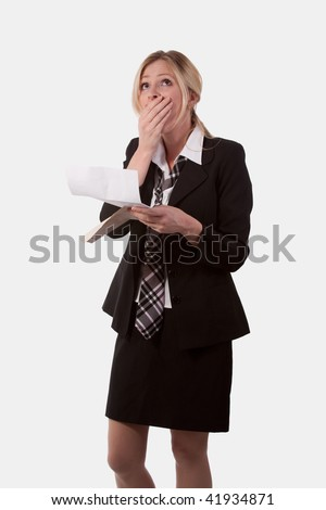 Attractive blond caucasian woman wearing a black business suit with tie holding an open envelope and a letter looking up with hand on mouth with a worried shocked expression