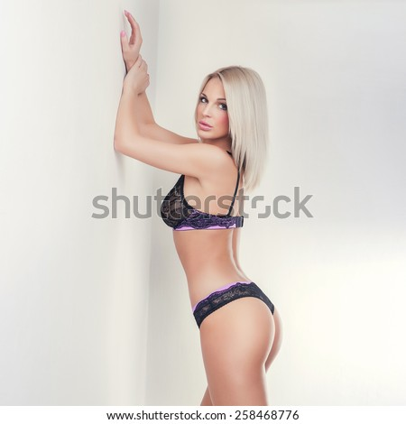 attractive blond girl in lace lingerie, butt without cellulite - stock photo