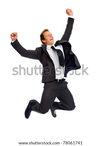Attractive blond man celebrates by jumping raises his fist overhead - stock photo