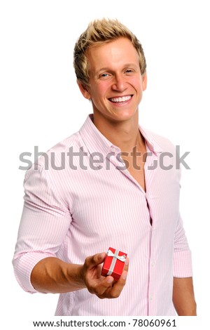 Attractive blond man holds a gift box that holds jewellery for Valentines Day