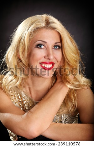 attractive blond woman closeup on the dark background - stock photo