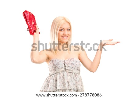 Attractive blond woman holding a red purse isolated on white background - stock photo