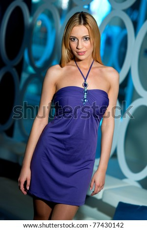 attractive blond woman in purple evening dress - stock photo
