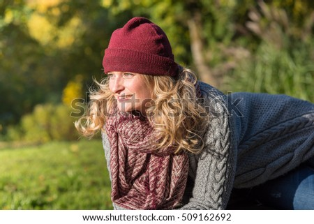 attractive blond woman in the park