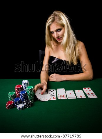 Attractive blond woman playing poker - stock photo