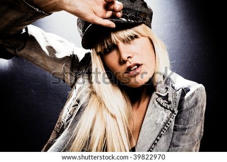 attractive blond woman wearing cap portrait - stock photo