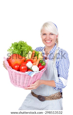 Attractive blond woman with a basket with vegetables isolated