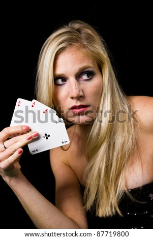 Attractive blond woman with 4 aces - stock photo