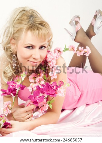 Attractive blond woman with flowers of sakura