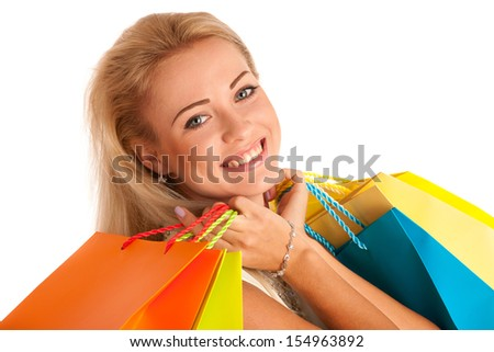Attractive blonde girl with colorful shopping bags isolated over white background