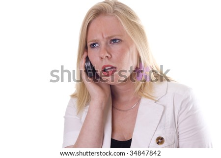Attractive blonde is listening on the phone with angry expression on face