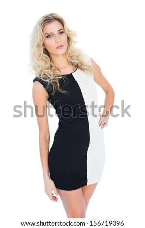 Attractive blonde model posing at camera on white background - stock photo