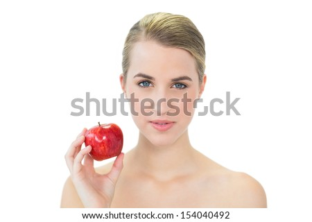 Attractive blonde on white background holding red apple