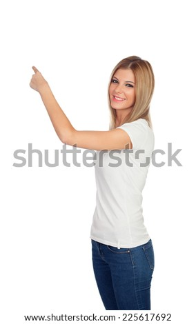 Attractive blonde pointing something with her finger isolated on a white background