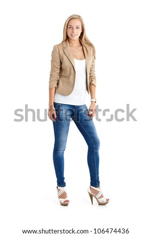 Attractive blonde teenager in trendy jeans and high heels, full length studio portrait. - stock photo