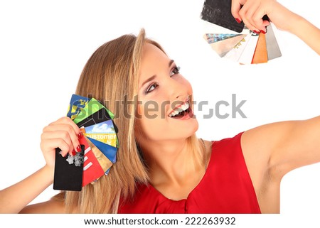 Attractive blonde with credit card in hand studio - stock photo