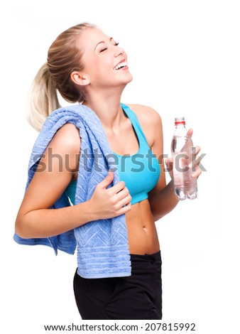 attractive blonde woman after workout drinking water  - stock photo