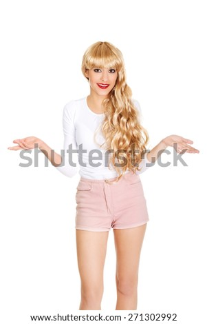 Attractive blonde woman in shorts with open hands. - stock photo