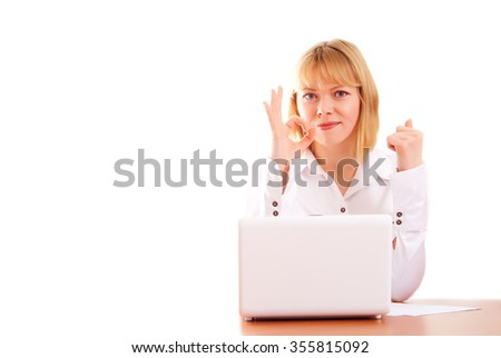 Attractive blonde woman making ok sign sitting in office on white background. - stock photo