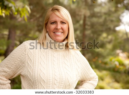 Attractive Blonde Woman Portrait in the Park. - stock photo