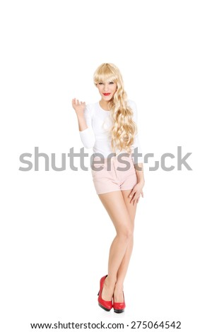 Attractive blonde woman posing in shorts and high heels. - stock photo