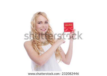 Attractive blonde woman with voucher - stock photo