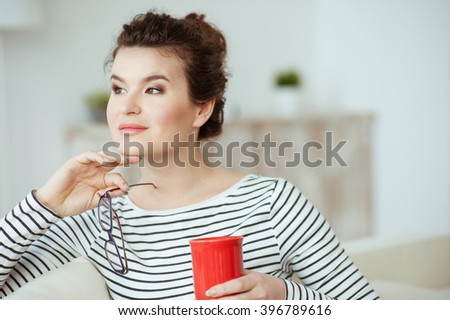 Attractive brunette girl is resting and dreaming - stock photo