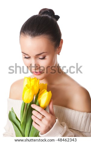 attractive brunette holding bunch of flowers isolated on white - stock photo