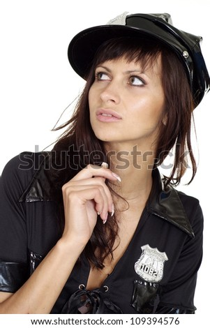 Attractive brunette in a suit of police on a white background - stock photo
