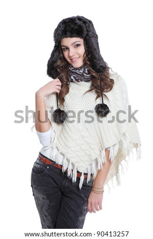 Attractive brunette posing with fur hat - stock photo