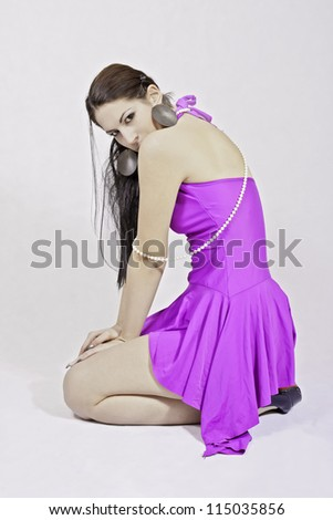 Attractive brunette wearing sexy dress - stock photo