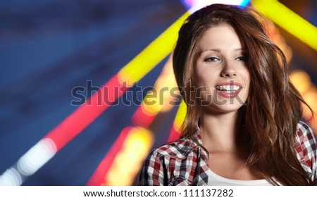 Attractive brunette woman against night city - stock photo