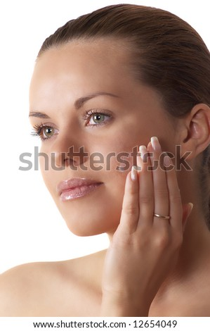 attractive brunette woman applying cream - stock photo